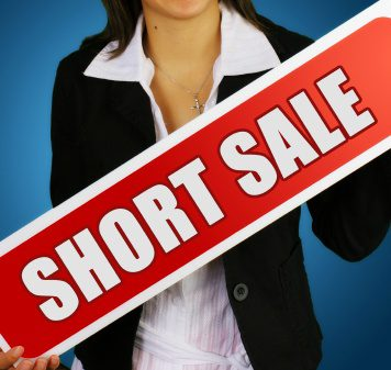 Lady holding up short sale sign