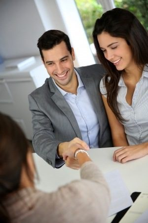 Couple shaking hands with Realtor